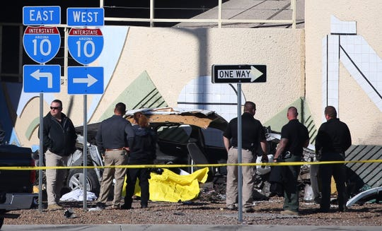 Investigators at the scene scene of a fatal crash on Speedway Boulevard near the I-10 overpass in Tucson, on Jan. 17, 2020.