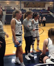 Amber Kintzer, left and Cassiah Ray, middle, have reunited with the Lebanon Valley College women's basketball team after playing together at Northern Lebanon. Ray is sitting out the season with a torn ACL, but Kintzer, after not playing basketball for two years, has become a valuable role player for LVC. At right is LVC's Sara White.