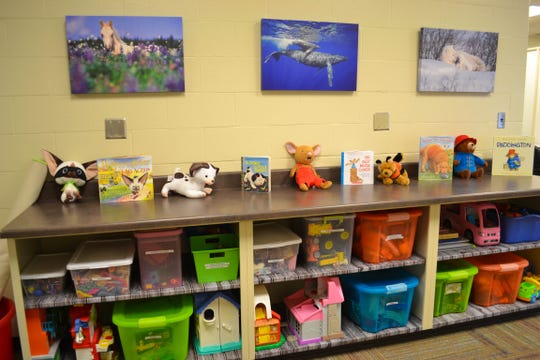 Toys and books await children in the common area.
