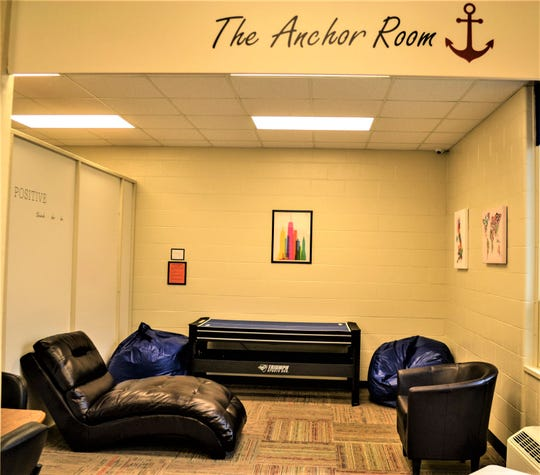 The Anchor Room for tweens and teens features an air hockey table and fun lounge chairs.
