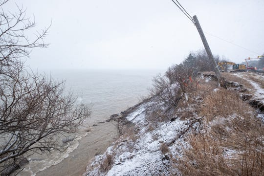 Michigan Department of Transportation crews are working to stabilize the slope and prevent further shoreline erosion along M-25 in Sanilac County.