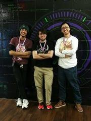 Hyde Park's Michael Davis, a video game maven, poses alongside fellow gamers Drew Merryman and Takanori Harada during the Xanadu Games tournament last November in Laurel, Maryland.