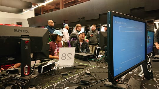 """Michael Davis, left, competes in the video game """"G30"""" during a Climb Cancel tournament in 2018 that he placed first in."""