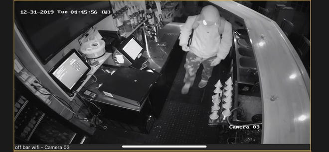 Surveillance footage from a burglary at Fireside BBQ & Grill in Pleasant Valley  on New Year's Eve.