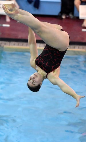 Dover's Meagan Tuohy completes a one and one half backwards summersault with a half twist in the free position during the Eagles swim meet against New Oxford, Thursday, January 16, 2020.John A. Pavoncello photo