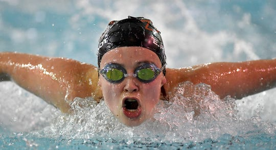 Emma Pequignot of Dover grabs a breath as she nears the 75 yard mark of the 100 butterfly event against New Oxford, Thursday, January 16, 2020.John A. Pavoncello photo