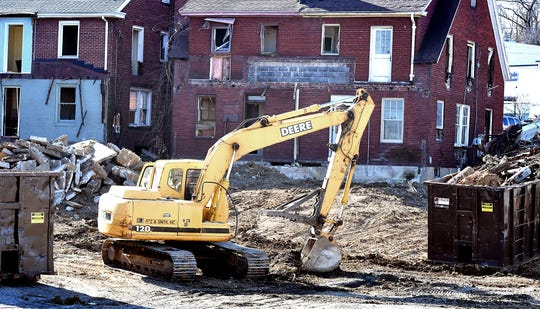 Demolition is underway to properties on the southeast corner of Route 30 and North George Street, January 17, 2020. Bill Kalina photo