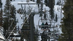 Skiers ride a life at Alpine Meadows ski resort Jan. 17. Certain parts of the resort remained open after an avalanche that morning killed one man and severely injured another.