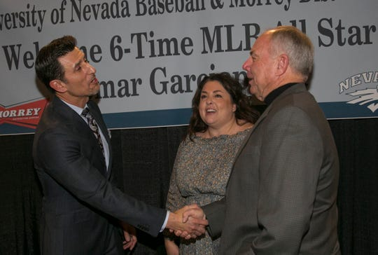 Nomar Garciaparra shakes hands with former Nevada head coach Gary Powers during the 36th Annual Bobby Dolan Baseball Dinner in the Reno Ballroom on Thursday.