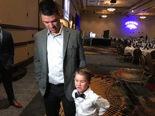 Nevada manager T.J. Bruce and his son Jackson before the Bobby Dolan baseball dinner on Thursday.