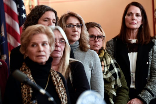 Family members of the victims from the Schohaire, N.Y., limousine crash listen to Senate and Assembly Democratic Majority members during a new conference to discuss legislation for limousine safety at the state Capitol on Tuesday, Jan. 14, 2020, in Albany, N.Y. (AP Photo/Hans Pennink)