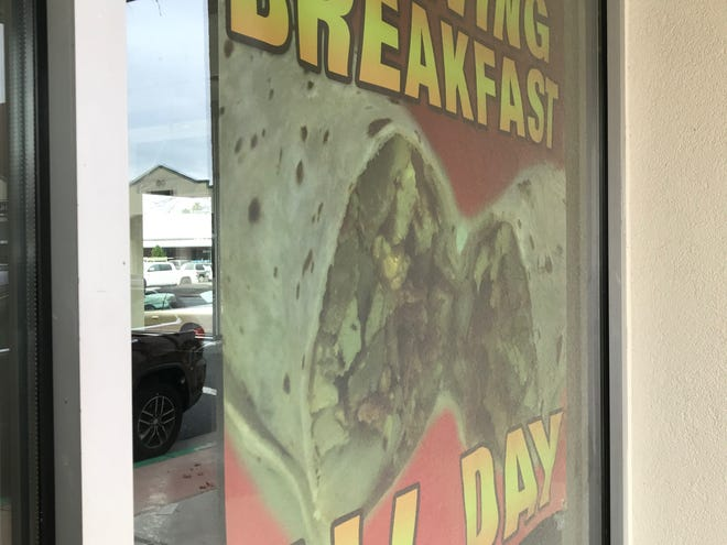 A poster of Mexican food is posted on the window of the former Wilda's in Cascade Square. The Mexican food restaurant Raliberto's is coming to the downtown Redding center.