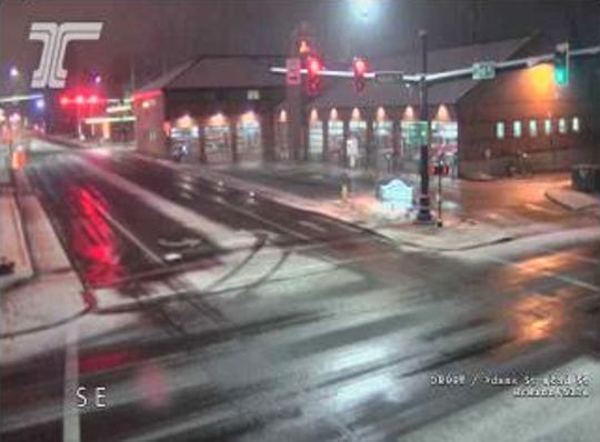 Snow covers sidewalks at the intersection of Highway 99W and 2nd Street in McMinnville early Friday morning.