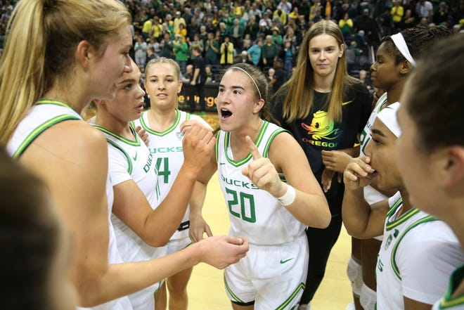 Oregon's Sabrina Ionescu, center, and teammates celebrate after defeating Stanford 87-55 during an NCAA college basketball game in Eugene, Ore., Thursday, Jan. 16, 2020.
