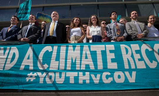 In this July 18, 2018, file photo, lawyers and youth plaintiffs lineup behind a banner after a hearing before Federal District Court Judge Ann Aiken between lawyers for the Trump Administration and the so called Climate Kids in Federal Court in Eugene, Ore.