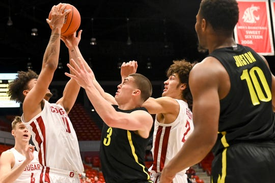Washington State forward DJ Rodman (11) pulls down a rebound away from Oregon guard Payton Pritchard (3) as forward CJ Elleby (2) watches during the first half of an NCAA college basketball game, Thursday, Jan. 16, 2020, in Pullman, Wash.