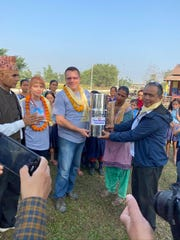 Terry Mikeska presents a water filtration system donated by San Angelo Chamber of Commerce vice-president of economic development Michael Looney (not pictured) for schools in Nepal.