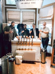 Four owners of the Plateau Brewing Company enjoying their creations.