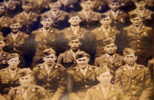 Gilberto Torres, center, in a photo taken of him as a young soldier before being deployed overseas during World War II.