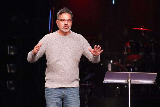 "Co-founder Mark DeYmaz speaks at the Mosaix Global Network's Multiethnic Church Conference on Nov. 5, 2019, in Keller, Texas. DeYmaz said the discussions at the conference, which now brings together more than 1,300 pastors, denominational leaders and researchers every three years, always demonstrate to him the contradictory reality of trying to unite black, white and other church traditions under one roof.  ""The way you get comfortable in a healthy multiethnic church is to realize that you go, 'Man, I'm uncomfortable here,'"" he said in an interview in early January."