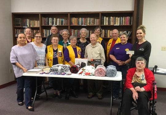 The Concho Pearls Lions Club recently donated blankets, puzzle books, small space heaters and money to aid the mission of San Angelo's Meals for the Elderly.  Pictured here are members of the Concho Pearls Lions Club posing with Meals for the Elderly Marketing and Event Director Danielle Dunagan (back row, far right) on Jan. 13.  Meals for the Elderly is a non-profit organization dedicated to serving warm noonday meals to the homebound disabled and frail elderly residing in Tom Green County and surrounding areas.