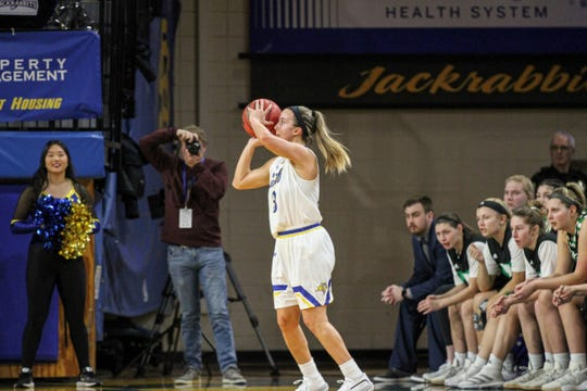 Lindsey Theuninck fires a jumper during Thursday's win over North Dakota at Frost Arena