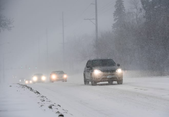 Cars drive up the road as Minnehaha County is under a Winter Storm Warning on Friday, Jan. 17, 2020 in near Kiwanis Avenue in Sioux Falls.