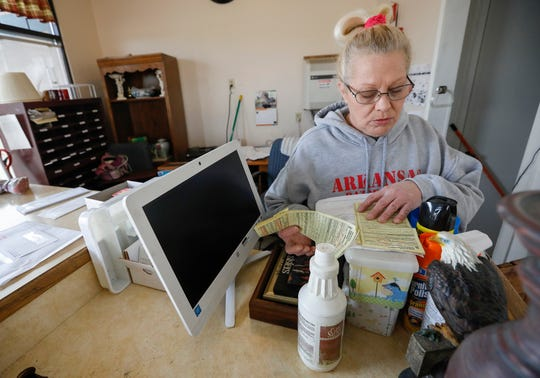 Margie Maric flips through a pile of tickets from the City of Branson in the office at the Travel Inns in Branson, Mo., on Wednesday, Jan. 15, 2020.