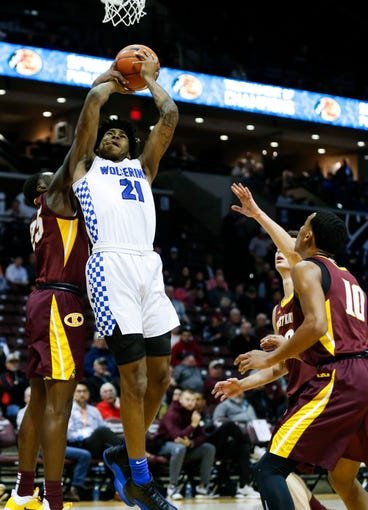 Vashon Wolverines Cam'ron Fletcher goes up for a field goal as Christ the King Royals Branson Williams swats the ball away during the Bass Pro Shops Tournament of Champions at JQH Arena on Thursday, Jan. 16, 2020.