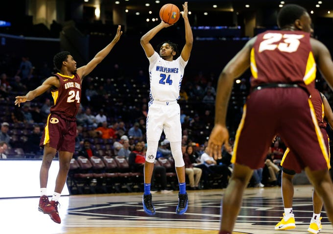 Vashon's Kobe Clark shoots a three-pointer over Christ the King's Jahlil Bethea during the Bass Pro Shops Tournament of Champions at JQH Arena on Thursday, Jan. 16, 2020.