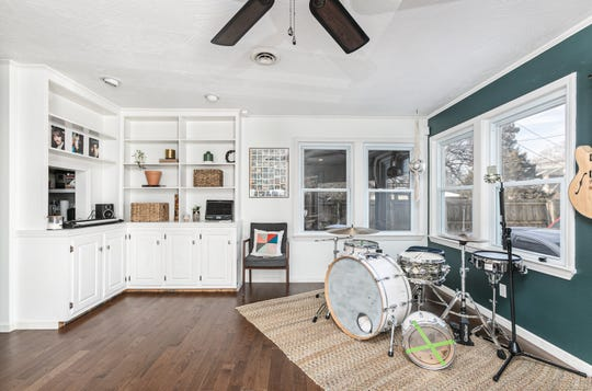 """A second living area created as part of an addition to the home's original footprint is Ivy's music studio. """"That's what I do for a living, so this is very important to me,"""" Ivy says."""