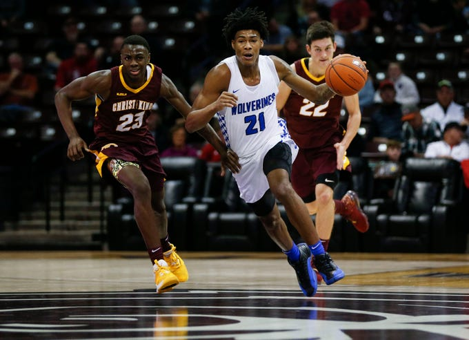 Vashon Wolverines Cam'ron Fletcher drives down court with Christ the King's Lovell Smith and Zisi Blades on his tail during the Bass Pro Shops Tournament of Champions at JQH Arena on Thursday, Jan. 16, 2020.