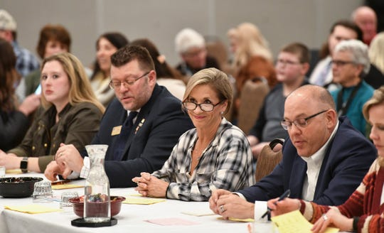 Judges look on during state auctioneer competition Thursday, Jan. 16, 2020, in St. Cloud.