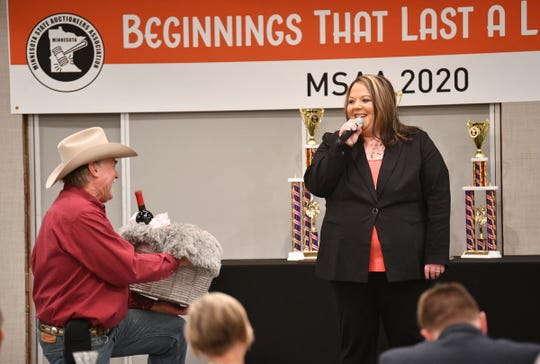 Jennifer Vogel prepares to compete during the Minnesota State Auctioneers Association Conference and Show Thursday, Jan. 16, 2020, in St. Cloud.