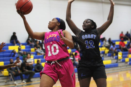 Rickards senior Ne'aysia Randall goes up and under for a layup as the Raiders' girls basketball team beat Godby 55-43 on Jan. 16, 2020.