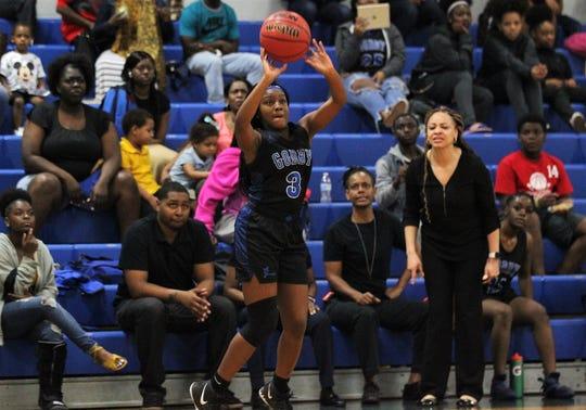 Godby senior Essence Nobles shoots a 3-pointer as Rickards' girls basketball team beat Godby 55-43 on Jan. 16, 2020.