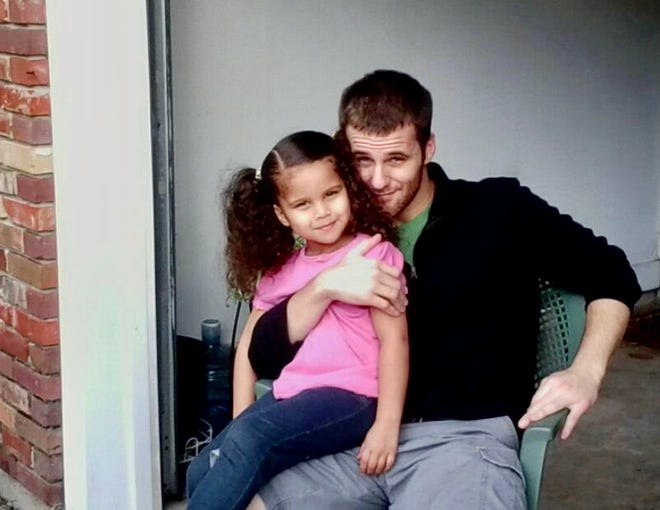 John Dees, a U.S. Army veteran who served in Iraq, pictured with his daughter. Dees was found dead Jan. 13, 2020, in a wooded area off Pecan Road on Tallahassee's west side. Dees, who struggled with personal demons after coming home from the war, had been shot.
