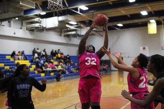 Rickards sophomore McKenzi Lyons grabs a rebound as Rickards' girls basketball team beat Godby 55-43 on Jan. 16, 2020.