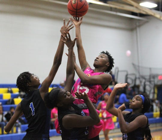 Rickards junior Ny'asia Green goes up for a basket over defenders as Rickards' girls basketball team beat Godby 55-43 on Jan. 16, 2020.