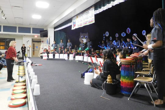 Music teacher Mary Register leads Art Club and Ritmos students in the finale at Springwood Elementary.