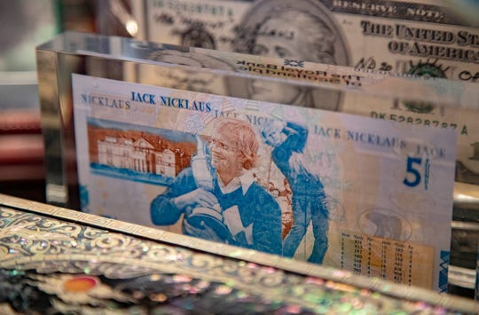 The trophy case In Jack Nicklaus's home office is filled with achievements. The Royal Bank of Scotland issued a commemorative five-pound note in 2005. Nicklaus is only the third person after the Queen and Queen Mother to be honored in this way during their lifetime.