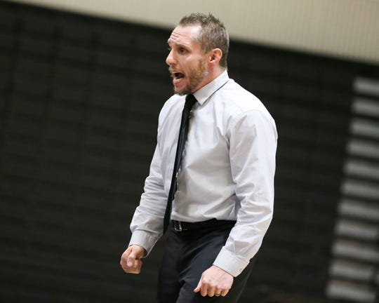 Jensen Beach wrestling coach Tom McMath shouts instructions as the Falcons compete against Cardinal Gibbons in a Region 4-1A dual wrestling semifinal at Jensen Beach High School on Thursday, Jan. 16, 2020.