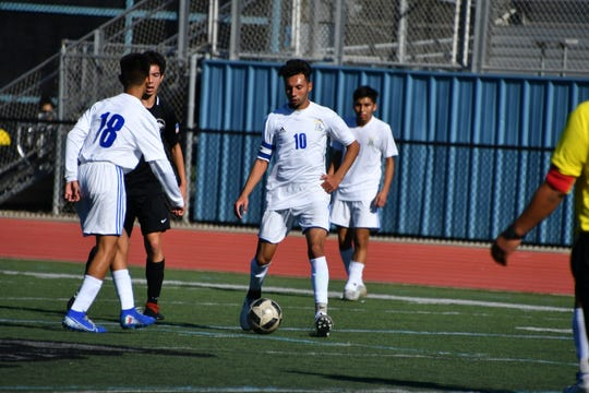 Fillmore striker Yobany Figueroa (10) passes the ball during the Flashes' 3-2 win over Foothill Tech at the Buena High tournament on Dec. 28.