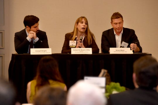Joslyn B. Stuart speaks with the audience  during the Economic Development Collaborative annual meeting on Jan. 16, 2020, at the Hyatt Regency Westlake. Fellow panelists included Joseph Briglio, left, and Erick Went.