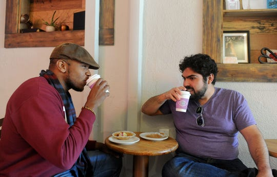Austin Campbell, left, and friend Giancarlo Bruni enjoy coffee drinks and pastries at Caffrodite Community Collective in Ventura. The combination coffeehouse, eco gift shop and collaborative space is working toward becoming a 501 (c)(3) nonprofit organization.