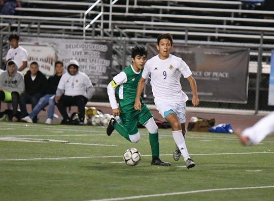Channel Islands striker Jesus De La Cruz looks up for a teammate against Thousand Oaks during the Raiders' 3-0 on Dec. 3. Channel Islands is the top seed in the CIF-SS Division 2 playoffs.