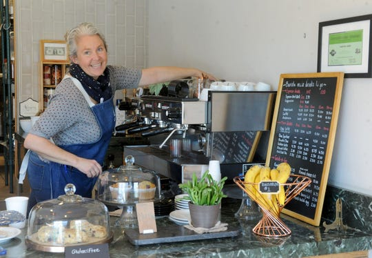 Christine Burke, founder and board member of Caffrodite Community Collective in Ventura, chats with a customer while preparing a coffee order. Burke and others are working toward turning the combination coffeehouse, eco gift shop and communal space into a 501 (c)(3) nonprofit organization.