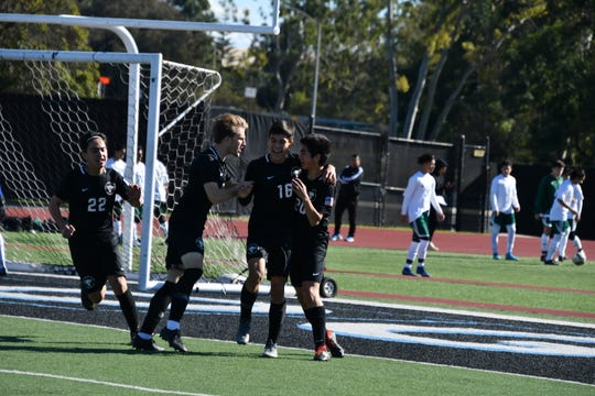 Foothill Tech's Michael Hernandez (16) is congratulated after scoring a goal during the Buena High tournament on Dec. 28.