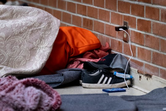 Homeless sleep on the floor in the warming center at St. Paul's Episcopal Church on Tuesday, January 14, 2020. Spots along the walls and near electrical outlets are taken first for the convenience of charging personal electronics.