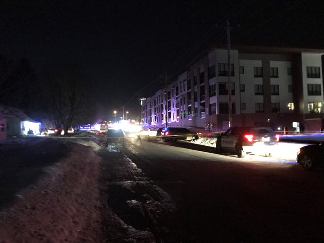 """Police set up caution tape near the scene of an """"active situation"""" on North 12th Avenue in Wausau on Thursday, Jan. 16, 2020."""